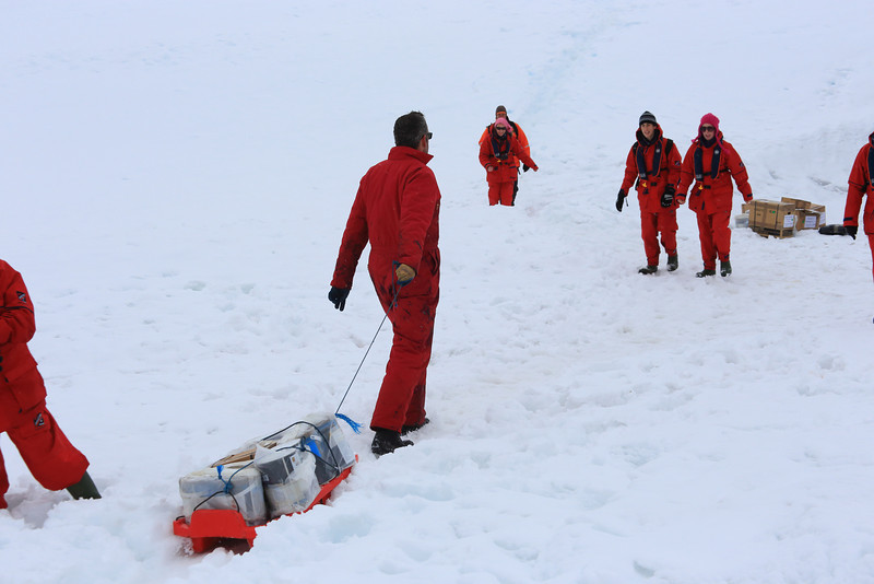 "Hauling supplies, South of the Antarctic Circle, Detaille Island, British scientific base ""W"" of the late 1950s at 66˚52'S, 66˚48'W"