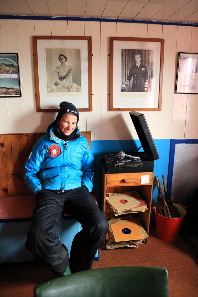 Historic British Base A, Port Lockroy on Goudier Island.  The lovely summer resident puts on an old record for me...  With a old record playing it's a wonderful place to write your postcards, inside the main buildings. If only a G&T was severed, that would complete the experience.