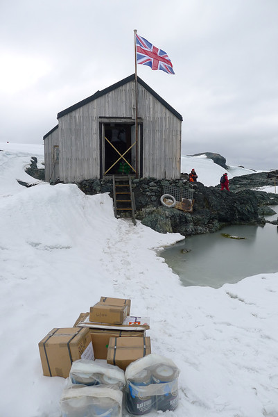 """No FedEx did not make this delivery......South of the Antarctic Circle,  Detaille Island, British scientific base """"W"""" of the late 1950s at 66˚52'S, 66˚48'W    The Vavilov OOE crew delivered supplies (some shown)  to the two occupants who are living here during the summer months.  It's also a UK Post Office. Mail from here is sent to the Falklands and then onto the UK for forwarding.  http://www.ats.aq/siteguidelines/documents/detaille_island_e.pdf"""