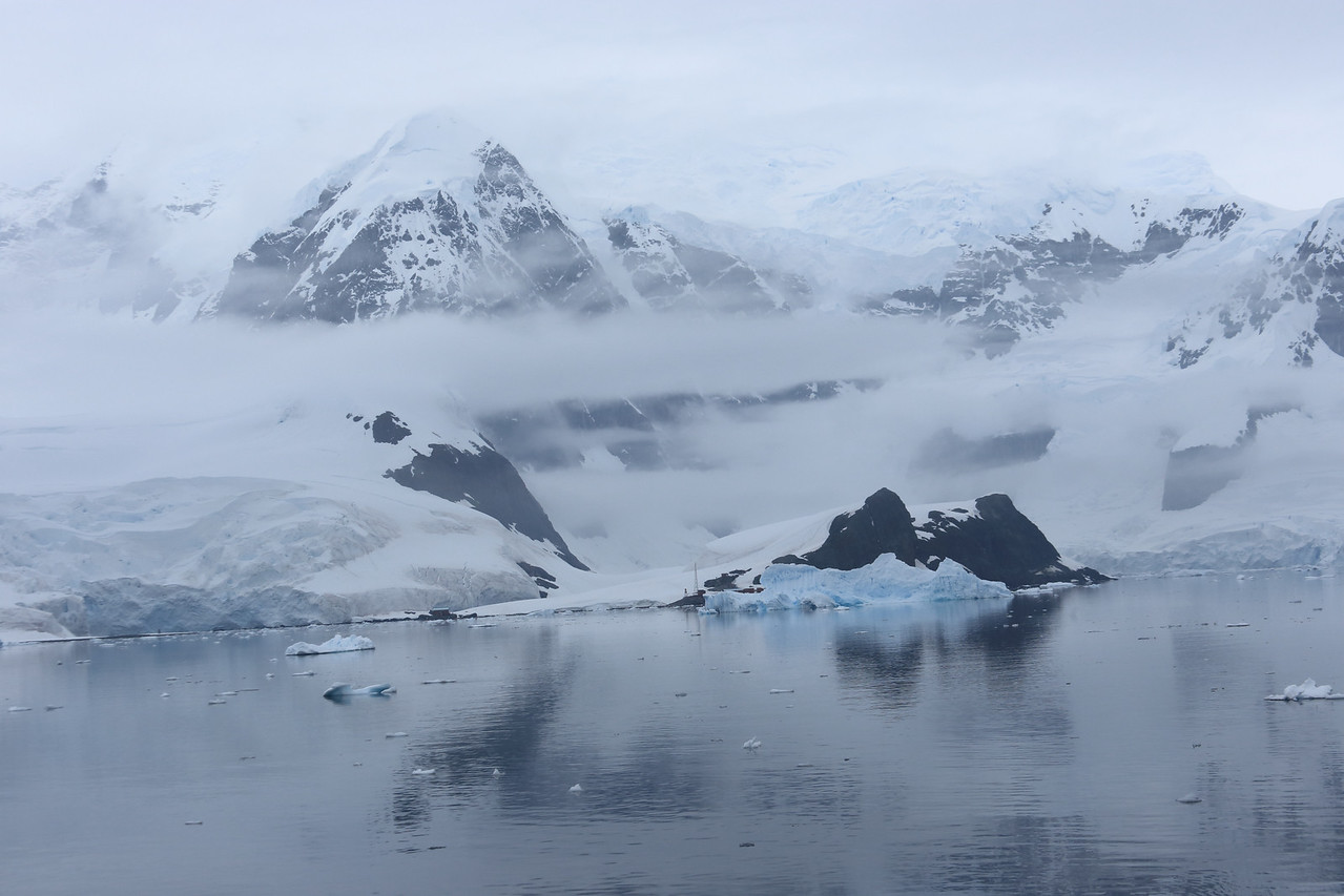 Paradise Harbor, glimpse of Almirante Brown Antarctic Base (64.895° S, 62.870° W) on the Antarctic mainland,