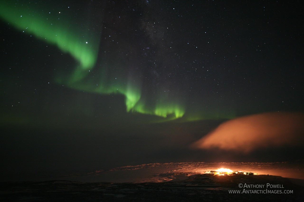 Aurora over Scott Base, Antarctica. A fog bank is rolling in from the South.