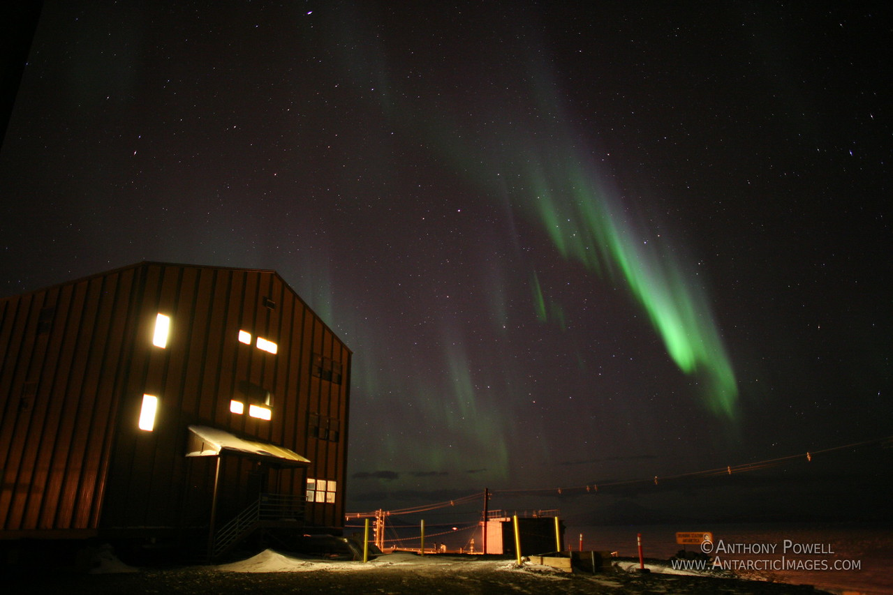 Aurora over one of the dormitory buildings at McMurdo Station.