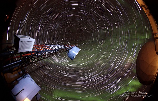 Star trails, looking straight up over about 2 hours the movement of the stars create an overhead circular pattern. The green bits in the sky are from some auroras that passed though the shot.