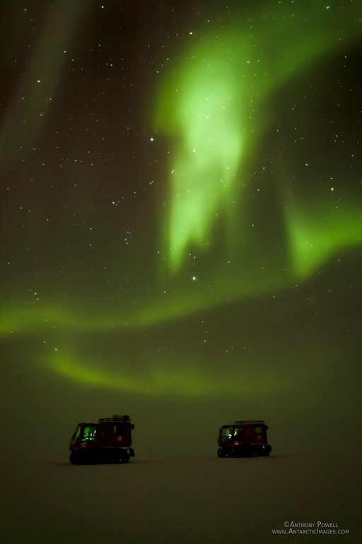Two Pisten Bully vehicles traversing across the Ice Shelf from Black Island back to McMurdo in foggy conditions with an aurora overhead turning the lighting green. Temperatures were approx -55 C out on the ice shelf this day, so I only managed one or two photos before the camera froze.