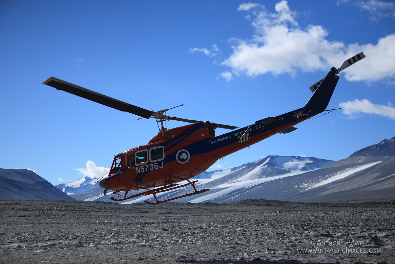 212 Helicopter departing a field camp in the Dry Valleys.