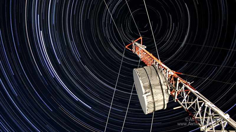 Stacked series of images looking up the microwave tower at Black Island, showing how the stars circle overhead.