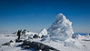 Anthony Powell and a volcanic ice fumarole near the summit of Mount Erebus