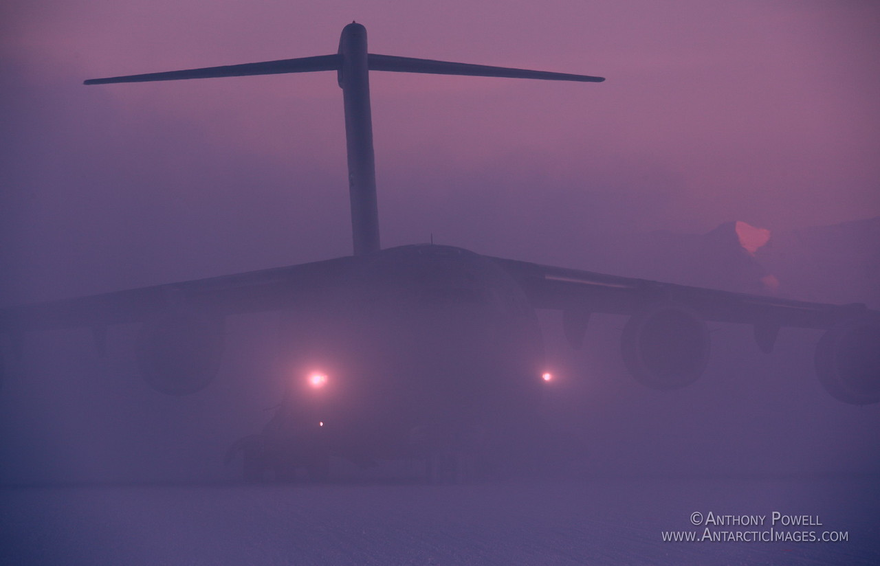 C-17 transport plane arriving at Winfly in the noon twilight and -45 degree fog