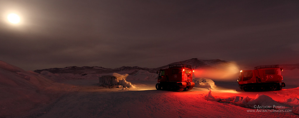 Pisten Bully vehicles traversing across the Ross Ice Shelf to Black Island in late winter.