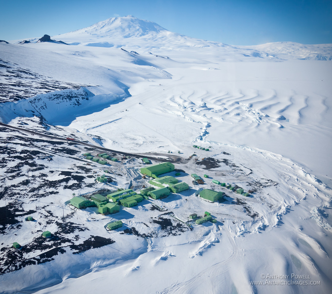 Scott Base, Antarctica. Mount Erebus is in the background, the pressure ridges in the ice are from the ice shelf pressing the sea ice against the shore.