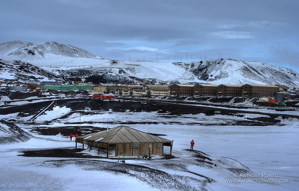 Scott's original Discovery Hut in the foreground, McMurdo Station in the background. HDR tone mapped image.