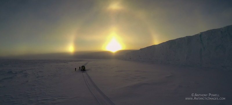 Sun dog and the Scott Base hagglunds on the sea ice next to the Barne Glacier.
