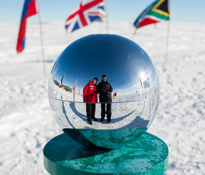 Looking at the ceremonial marker for the South Pole.