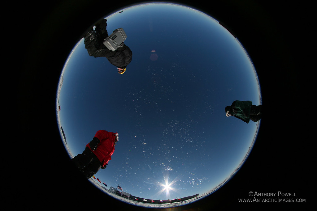 """Looking """"Down"""" off the bottom of the planet at the South Pole. Fish-eye shot from the camera that was capturing the sun making a 360 degree circle in the sky. The white specs are blowing snow."""