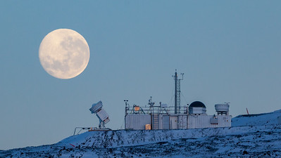 Full moon passing behind the Atmospheric Radiation Measuring facility