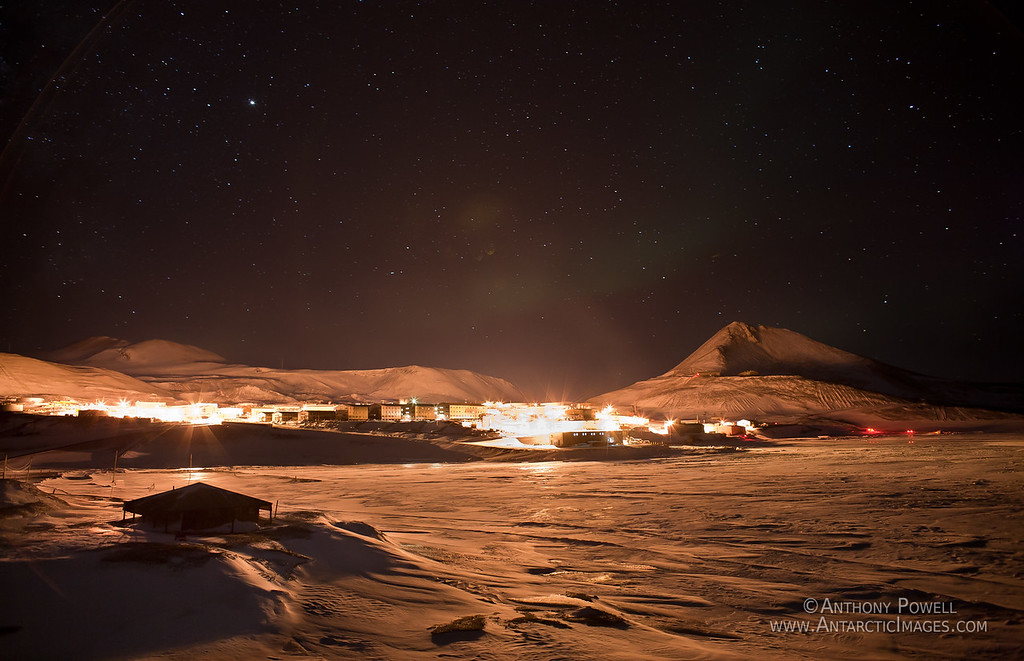 McMurdo Station and Discovery Hut on a still day during the Antarctic Winter.