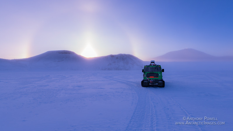 Sun dog, and the Scott Base hagglunds on the sea ice near Cape Royds.