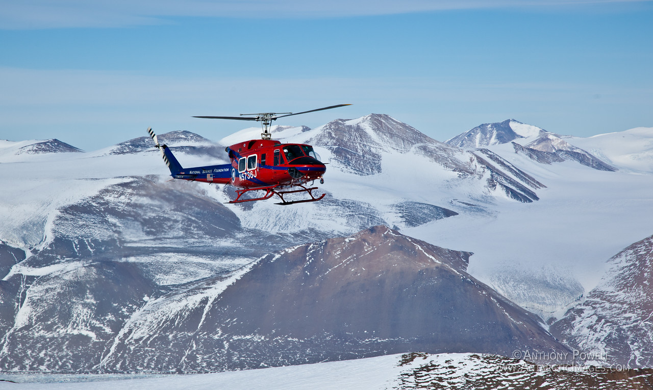 212 Helicopter approaching Mount Voslips, Dry Valleys, Antarctica.