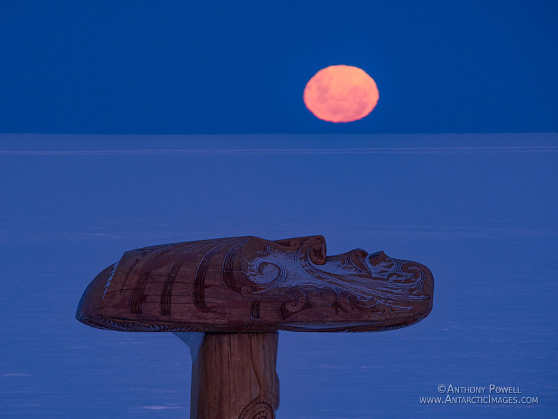 Top face of the Scott Base Pouwhenua watching the full moon rise above the Ross Ice Shelf.