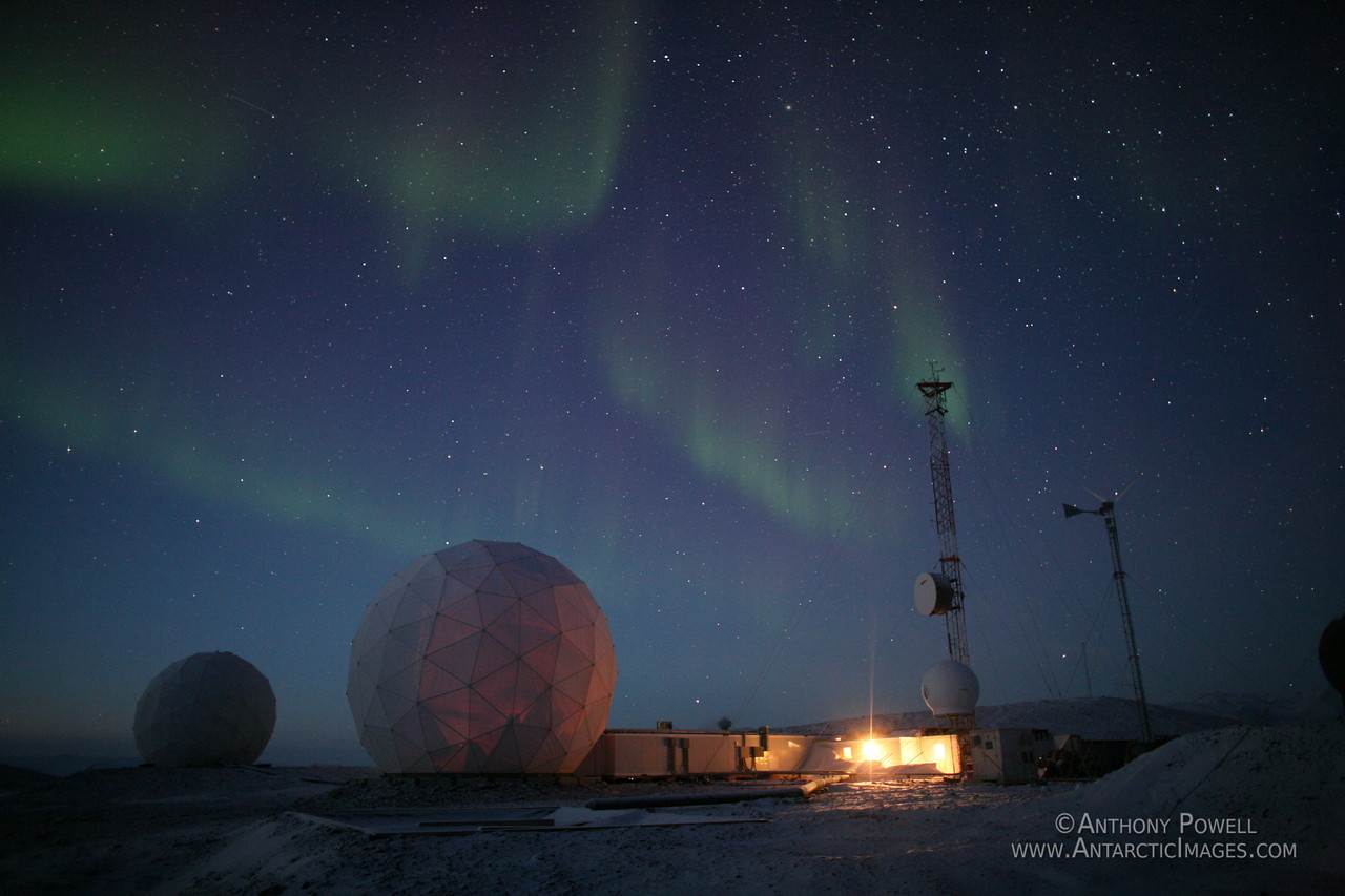 Black Island Antarctica Telecommunications Facility. Auroras over the Black Island ground station at 11.30 in the morning in July.