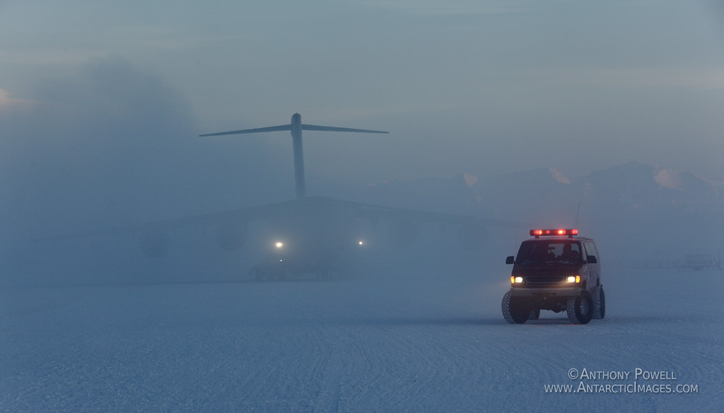 Arriving C-17 Plane being guided to a parking spot on the Ice Shelf at the Pegasus Airfield