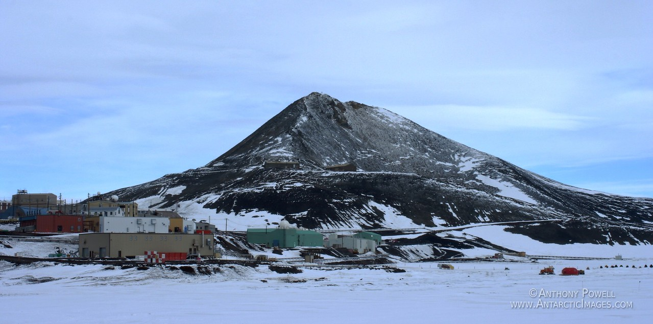 McMurdo Station power, water, and waste plants in the foreground as seen from Hut Point.