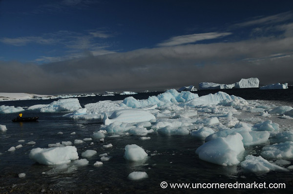 Small Zodiac Amidst the Icebergs - Antarctica