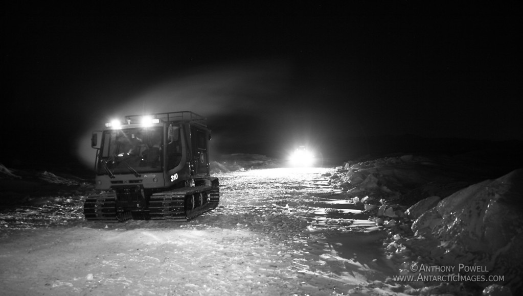 Pisten Bully vehicle traversing across the Ross Ice Shelf during the Antarctic Winter.