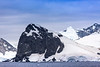 Mountains, glaciers and icebergs near Cuverville Island, Antarctic Peninsula, Antarctica.