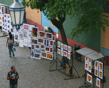 Local artists diplay their work all along Caminito.