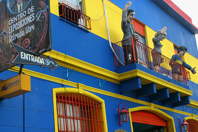 """La Boca is known as the birthplace of the tango and the local futbol team - Boca Juniors.  On the balcony of this building, not only did they recreate the """"Evita balcony scene,"""" but they added a figure dressed in the Boca Junior uniform."""