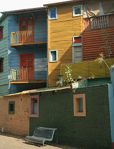 La Boca is a barrio (neighborhood) in Buenos Aires.  It was founded by immigrants.  These are some of the colorfully painted buildings on Caminito (pedestrian walkway), which serves as a street museum.