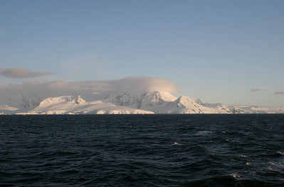 We are on deck before breakfast, enjoying the sights as we cruise through Gerlache Strait on our way to Errera Channel.