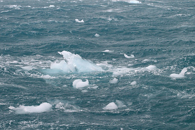 Chunks of ice awash in the swells.