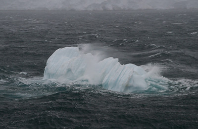 The few bergs that are in the channel are taking a beating from the ocean and wind.