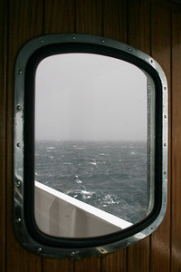 The storm that cut short our visit to Port Lockroy has intensified.  This is all that is visible of Neumayer Channel.