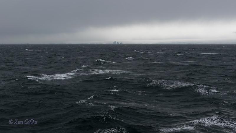 Distant Icebergs on the Ocean