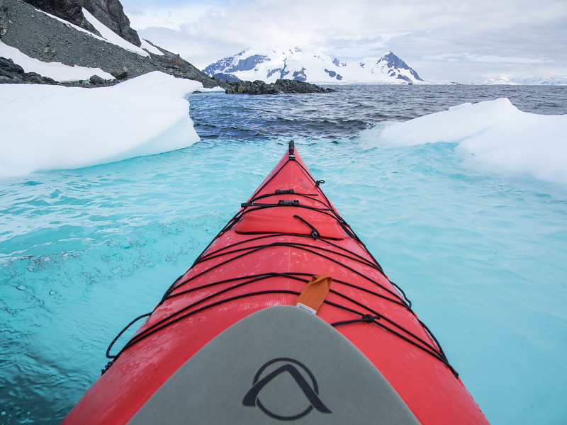 Kayaking over the tongue of an iceberg
