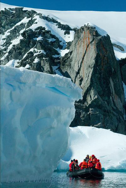 Zodiac next to iceberg, Melchior Islands, Antarctica