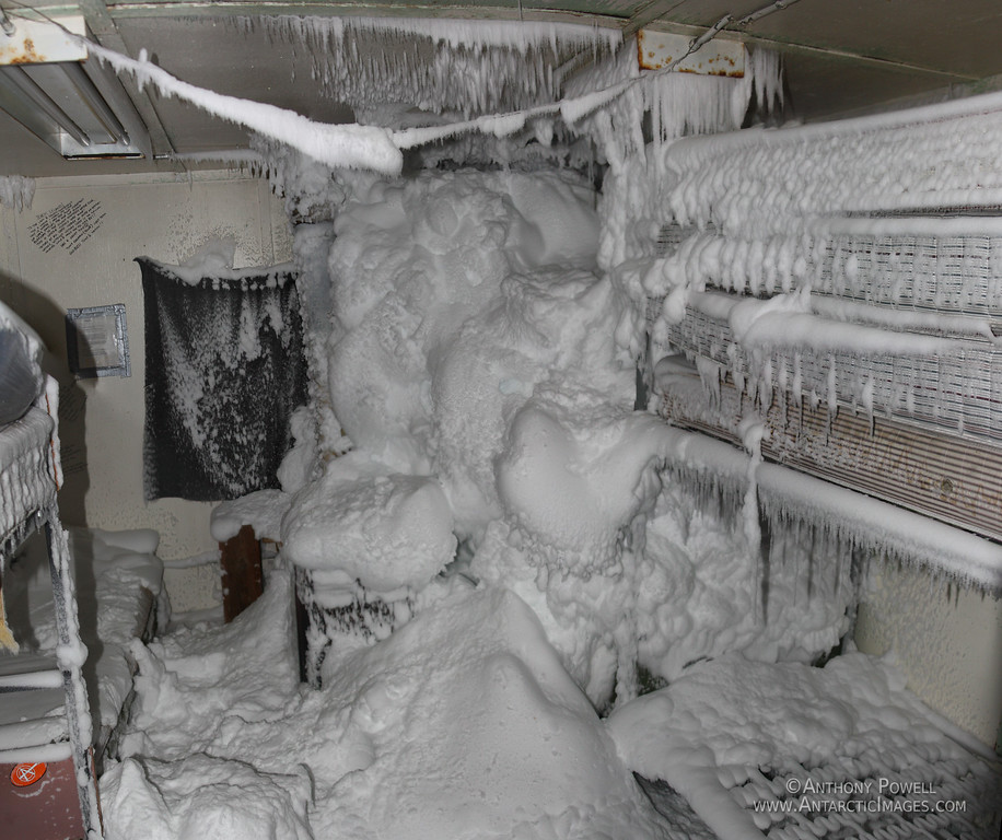 The inside of the bunk house at Black Island after a storm. All this snow has worked its way into the building through the tiny gaps in the window seals and frame work.<br /> There are a couple of armchairs and a diesel pre-way heater in the corner on the right of the picture under all the snow.