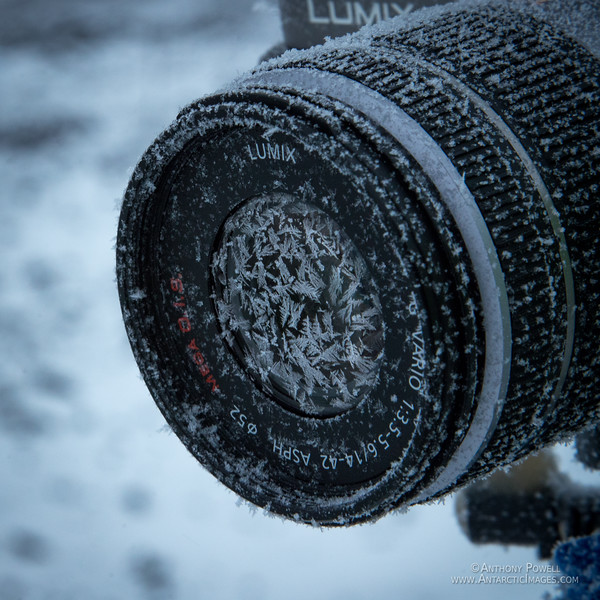 Ice crystals building up on the lens of a camera.