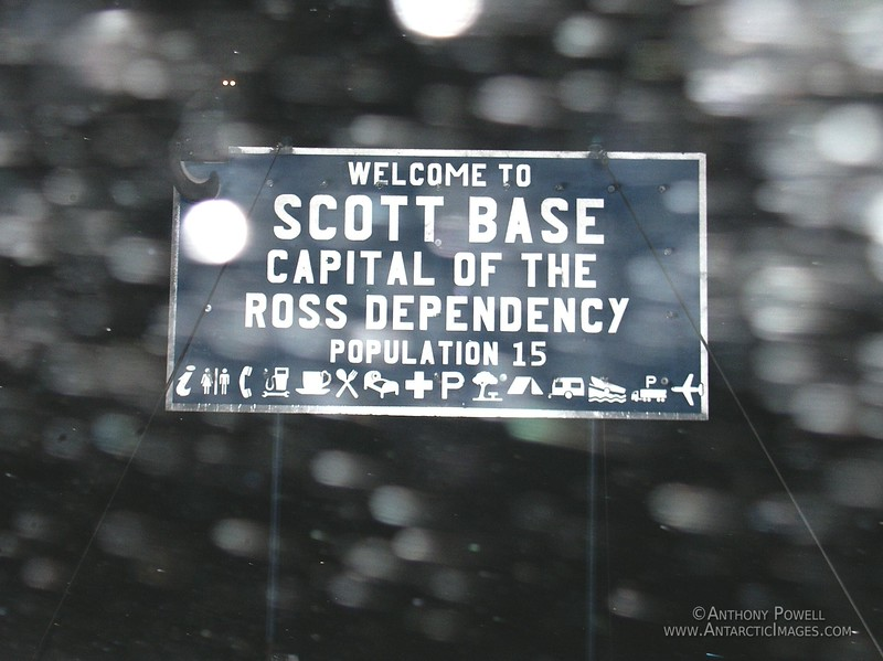 Scott Base road sign in stormy weather.