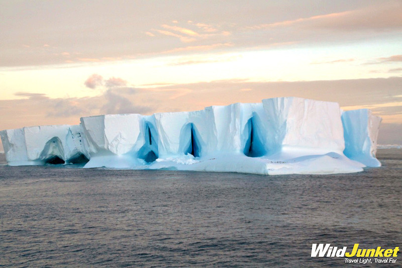 An enormous iceberg with arcs and curves