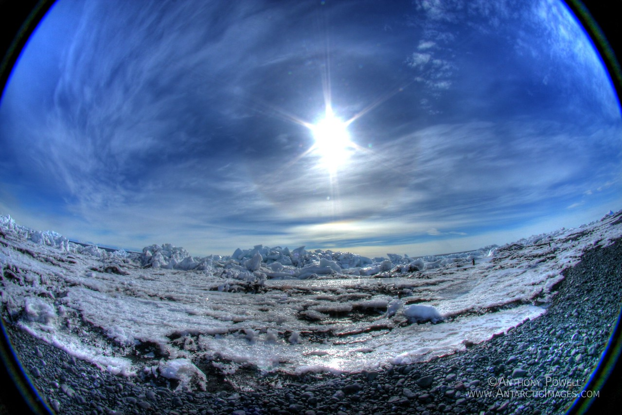 180 degree view of the beach at Cape Bird. The ring around the sun is caused by ice crystals in the air, commonly referred to as a sun dog.