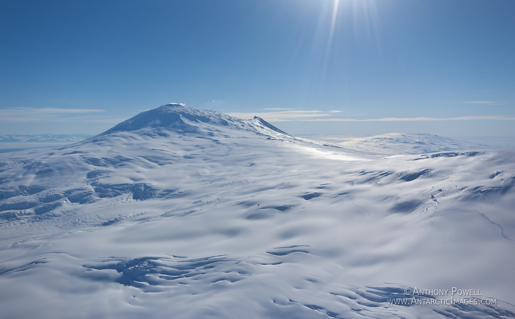 Mount Erebus and crevass fields. Mount bird is in the background to the right, and Mount Terra Nova on the right of the picture.