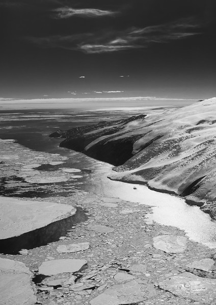 Cape Bird, Antarctica, as seen from the air over the pack ice.