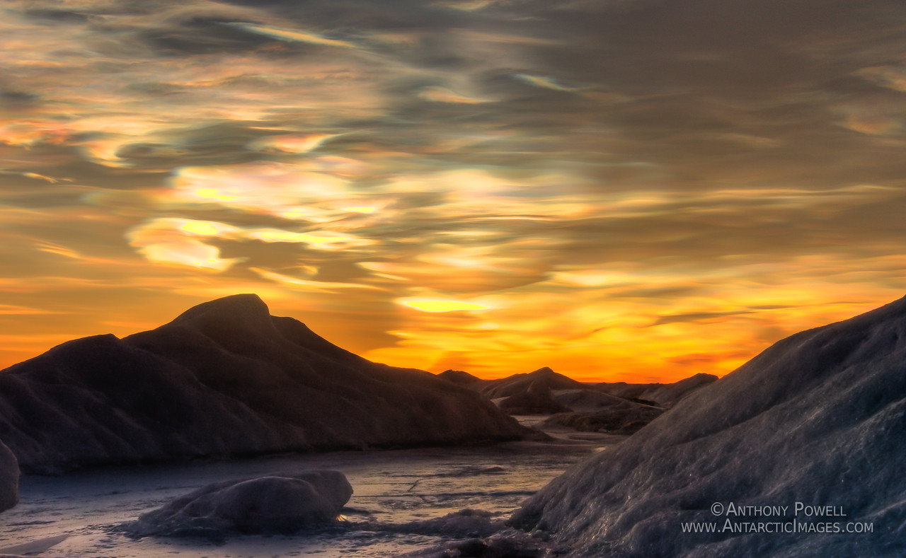 Nacreous Clouds over the melt channels in the ice shelf in front of Black Island, Antarctica.
