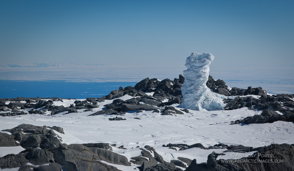 Ice fumarole near the summit of Mount Erebus. Steam coming out of volcanic vents in the ground freezes as it hits the cold air, creating chimneys of ice.