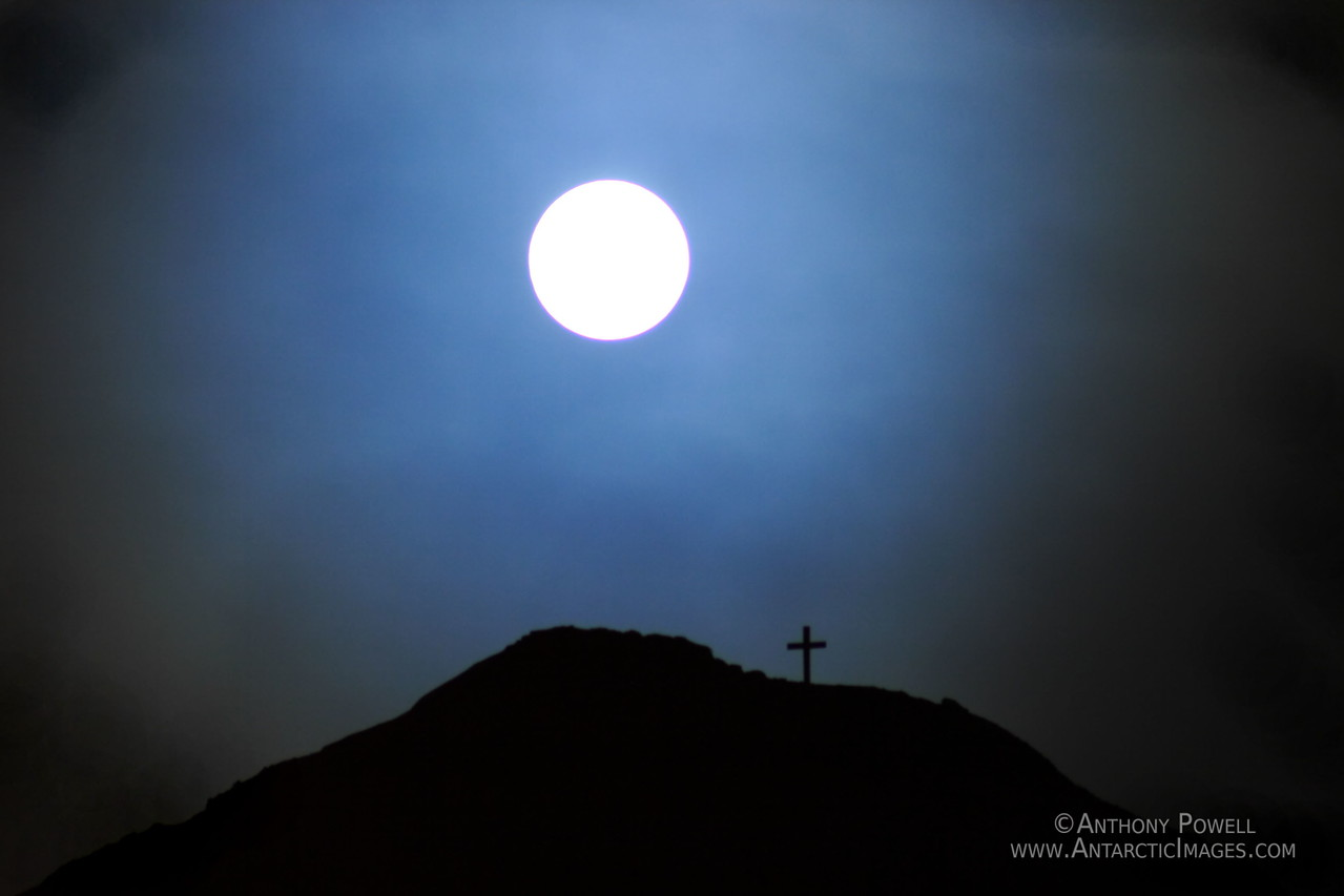 Full Moon over Observation Hill. The cross is the memorial marker to Robert Scott and his men who died returning from the South Pole in 1914.