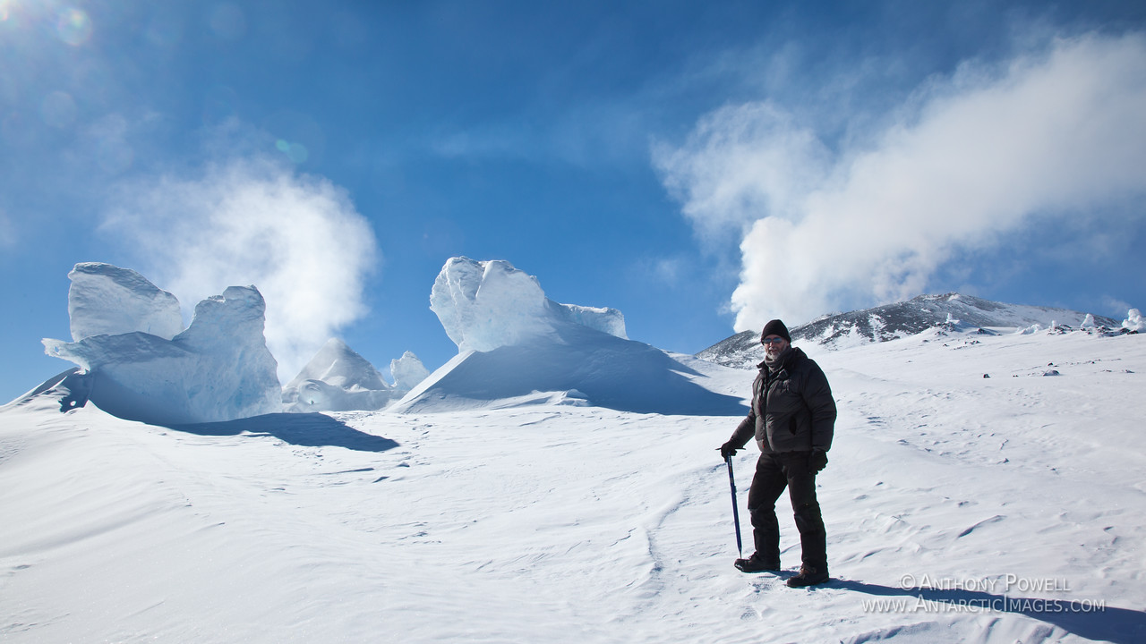 Near one of the volcanic vents just below the summit of Mount Erebus which is steaming away in the background.